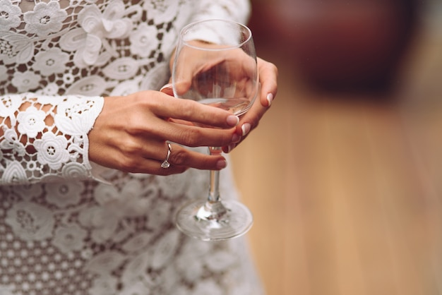 Bride holding a glass of champagne. wedding celebrations, wedding dinner