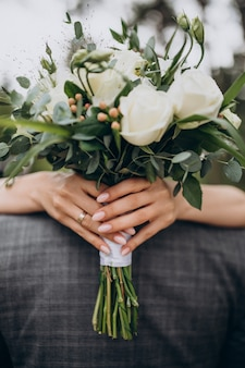 Bride holding her wedding bouquet