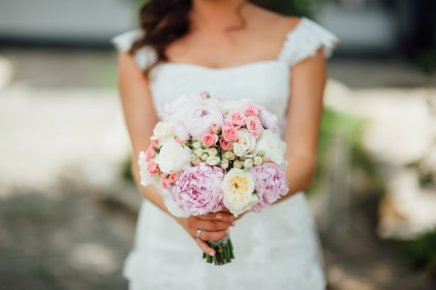Bride holding wedding bouquet on ceremony