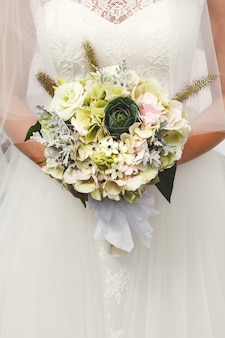 Bride holding wedding bouquet flowers