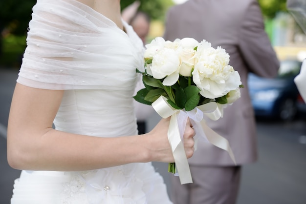 Bride holding wedding flowers bouquet