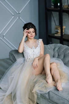 The bride is a european-looking brunette, single portrait. wedding makeup and hairstyle. morning of the bride. boudoir at the hotel.