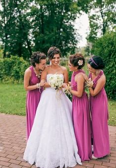 A bride laughs while surrounded by her bridesmaids at a fun spanish wedding.