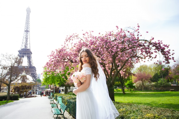 Bride in a luxurious wedding dress in paris