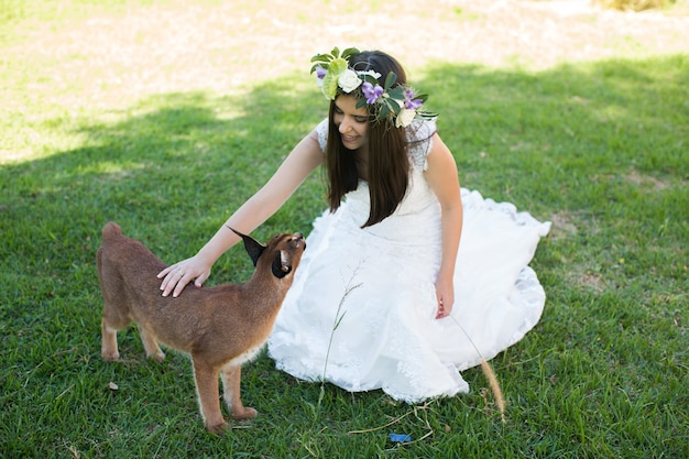 Bride and lynx in the garden