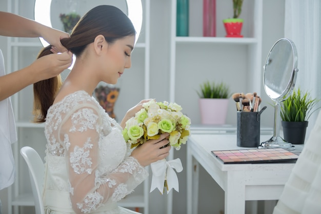 Bride make hair with dress