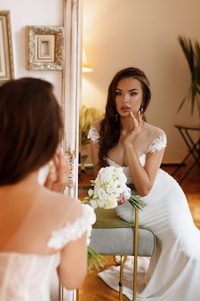 Bride at the mirror in the morning on the wedding day