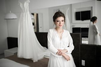 Bride on her wedding day morning preparation