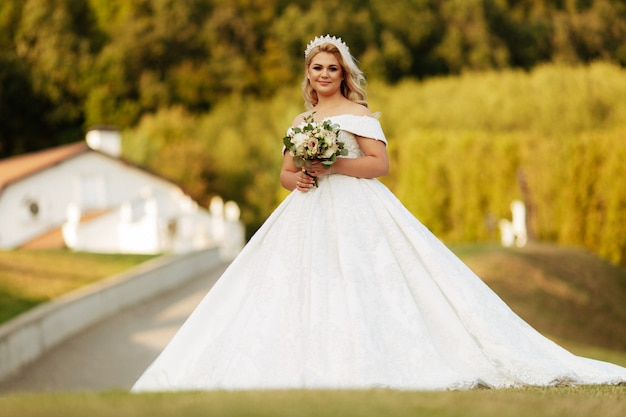 The bride portrait in the autumn forest. bride in wedding dress on natural background. wedding day.