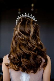 Bride preparing for her wedding hairstyle makes