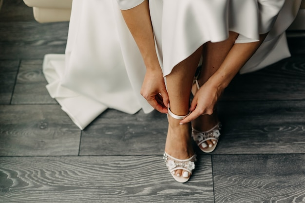 Bride putting on her shoes, close up
