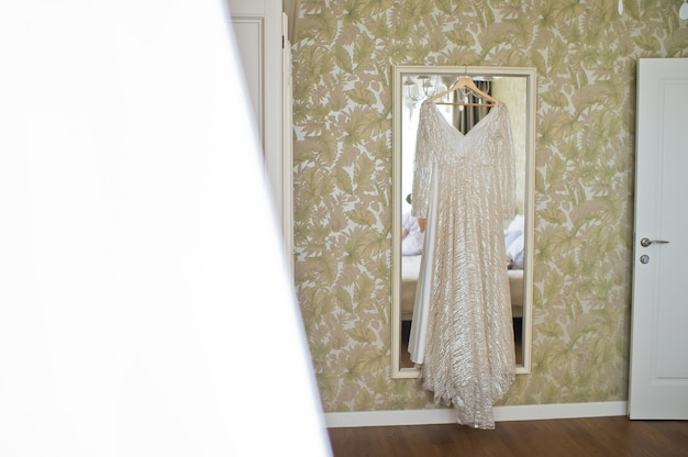 Bride's dress in the hotel room.