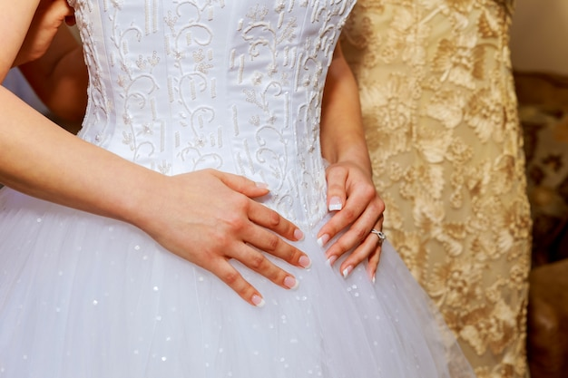 Bride's morning. young beautiful bride in white wedding dress gracefully put hand together