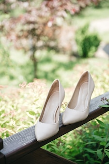 The bride's shoes are on the balcony