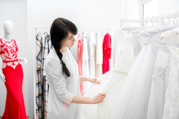 Bride selects the wedding dress