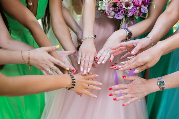 Bride show her wedding ring to bridesmaids