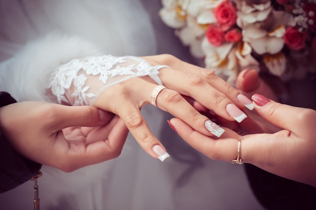 Bride shows the wedding ring to girlfriends
