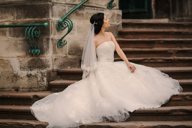 Bride sitting in the stairs