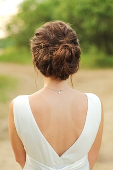 The bride stands with her back to the veil