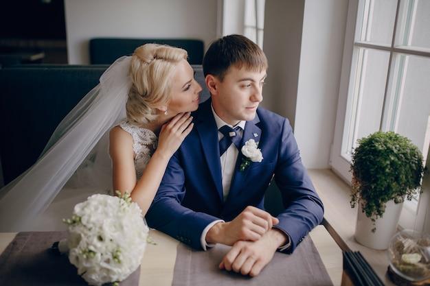 Bride talking to groom's ear