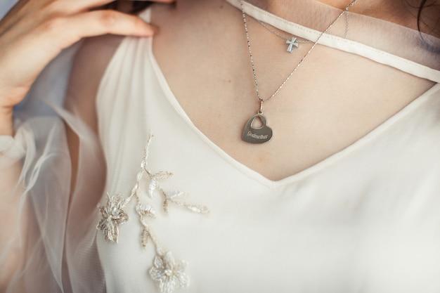 Bride wearing heart necklace