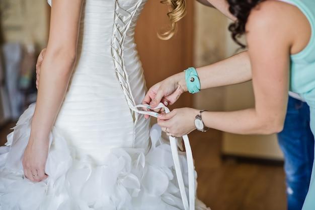 The bride wears a wedding dress