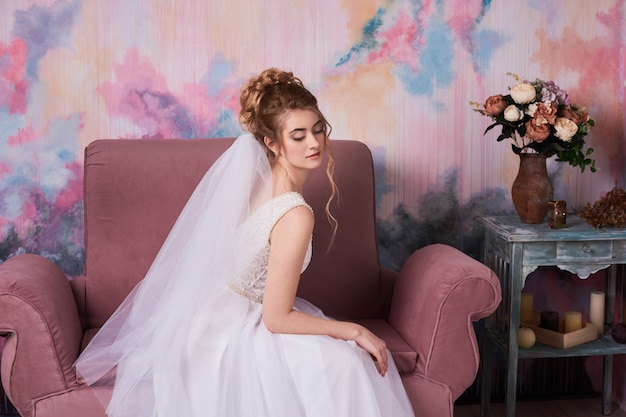 Bride in wedding dress wait for groom during morning gatherings at home