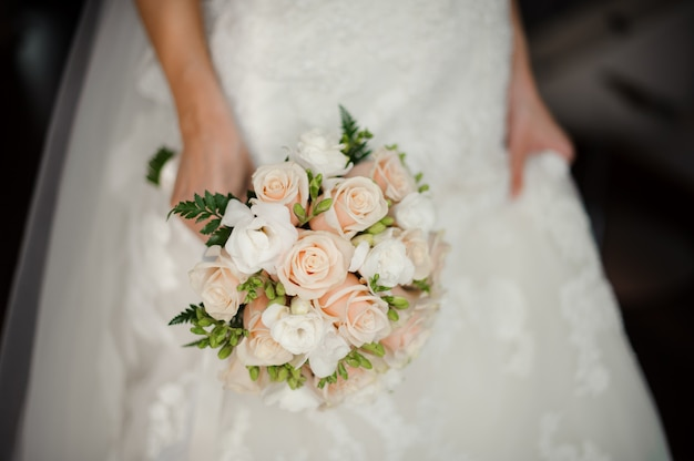 Bride in white dress holding a bouquet