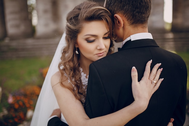 Bride with her hand on her husband's back