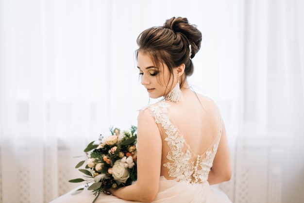Bride with luxurious hairstyle and make up in the morning