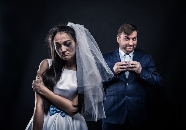 Bride with tearful face and groom with sly smile