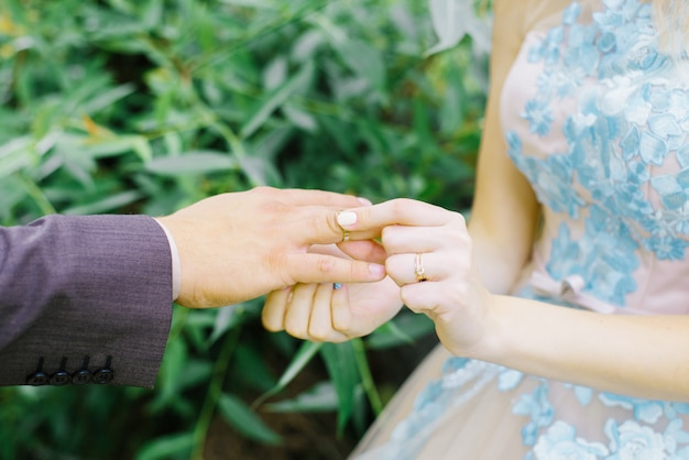 The bride wore a ring for the groom. newlyweds with rings on their fingers on their wedding day.wedding ceremony close-up.