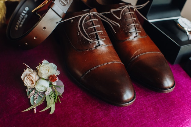 Bridegroom's shoes with other wedding details