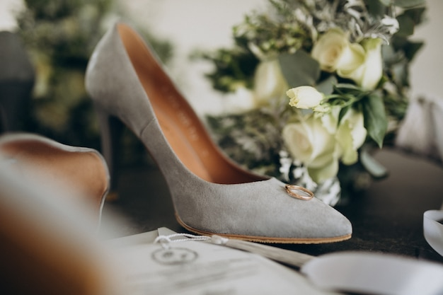 Brides wedding shoes with wedding bouquet