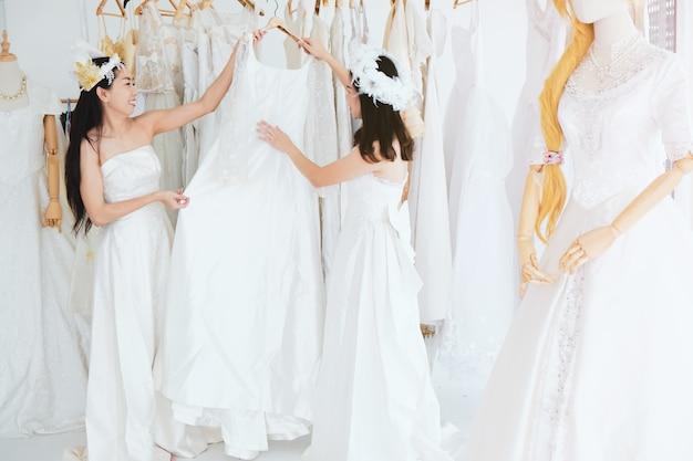 Bridesmaid dress rehearsal at the tailor shop.