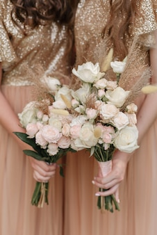 Bridesmaids and bouquets rose gold