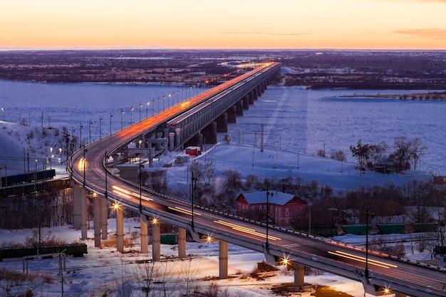 Bridge over amur river in khabarovsk, russia in winter