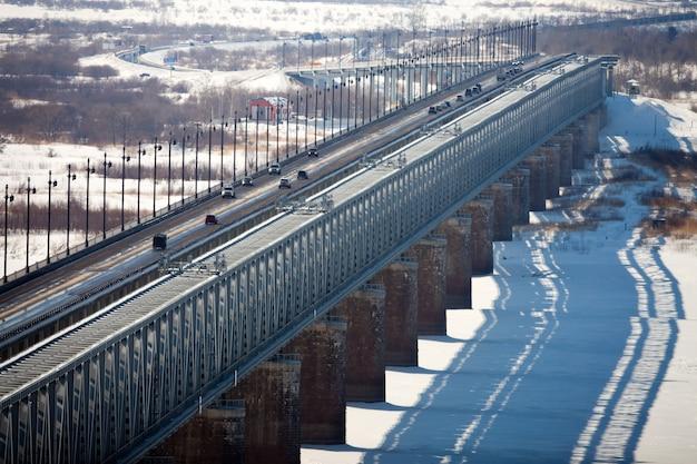 Bridge over the frozen river in winter