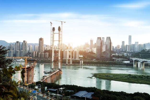 The bridge is being built across the yangtze river in chongqing, china.
