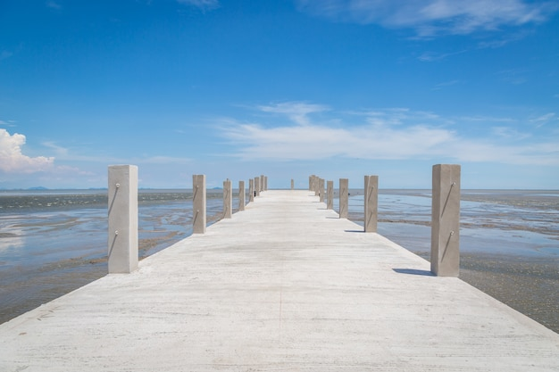 Bridge to the sea with blue sky background