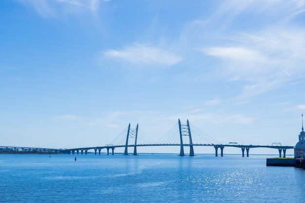 The bridge in st. petersburg. beautiful view of the gulf of finland, st. petersburg, russia, big river view. krestovsky island. neva river. bridge leading to the highway