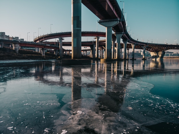 Bridge with reflection on iced river in seoul