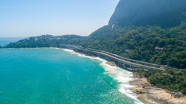 Bridges by the beach. waves crashing on the rocks. rio de janeiro, brazil