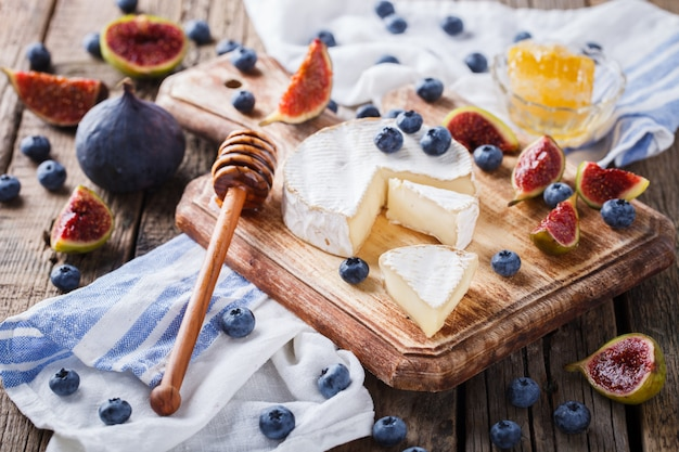 Brie cheese,camembert with ingram,blueberries and honey