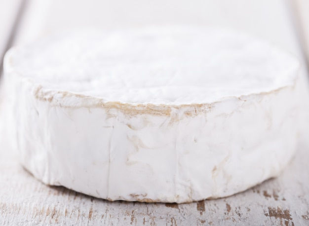 Brie cheese on white background