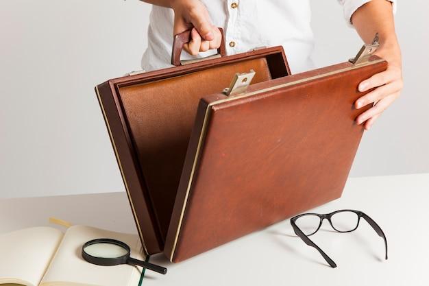 Briefcase, loupe adn glasses