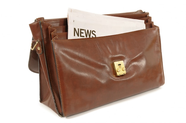 Briefcase with newspaper