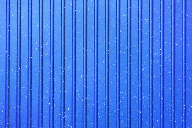 Bright abstract background of blue color. fluted texture. wallpaper.