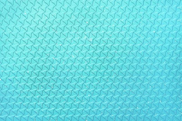 明るい抽象的な青い色の背景。グリル鍋の表面のテクスチャ。