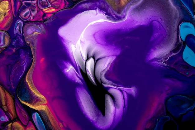 Bright abstract fluid art background dark purple and blue colors. liquid acrylic painting on canvas with golden gradient and splash. watercolor backdrop with waves pattern.